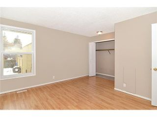 Photo 9: 409 RANCHVIEW Court NW in CALGARY: Ranchlands Residential Attached for sale (Calgary)  : MLS®# C3554095