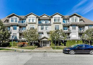"Photo 1: 404 15323 17A Avenue in Surrey: King George Corridor Condo for sale in ""SEMIAHMOO PLACE"" (South Surrey White Rock)  : MLS®# R2308322"