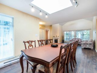 Photo 2: 404 2733 ATLIN PLACE in Coquitlam: Coquitlam East Condo for sale : MLS®# R2419896