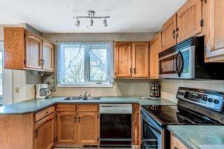 Photo 9: 116 6103 Madigan Drive NE in Calgary: Marlborough Park Row/Townhouse for sale : MLS®# A1111387