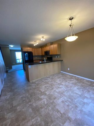 Photo 4: 321 Sunrise Terrace NE: High River Row/Townhouse for sale : MLS®# A1062467