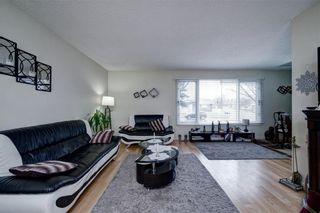 Photo 4: 14703 Deer Ridge Drive SE in Calgary: Deer Ridge Detached for sale : MLS®# A1126639