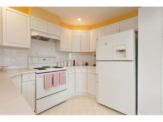 """Photo 8: 128 13888 70TH Avenue in Surrey: East Newton Townhouse for sale in """"Chelsea Gardens"""" : MLS®# F1440954"""