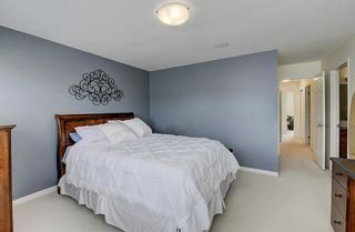 Photo 10: 3 EVERRIDGE Villa SW in Calgary: Evergreen Semi Detached for sale : MLS®# C4297700