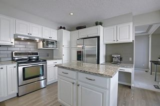 Photo 9: 11 Strathcanna Court SW in Calgary: Strathcona Park Detached for sale : MLS®# A1079012