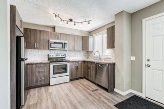 Photo 11: 25 2319 56 Street NE in Calgary: Pineridge Row/Townhouse for sale : MLS®# A1152342