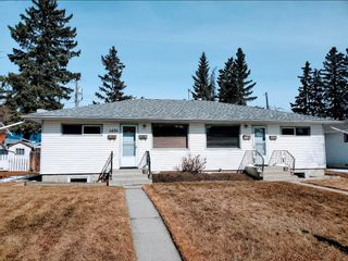 Main Photo: 1424 Rosehill Drive NW in Calgary: Rosemont Semi Detached for sale : MLS®# A1075121