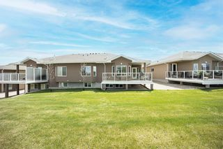 Photo 4: 37 River Heights View: Cochrane Semi Detached for sale : MLS®# A1113108