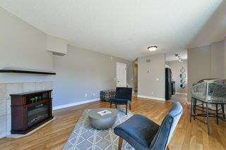 Photo 10: 1301 829 Coach Bluff Crescent in Calgary: Coach Hill Row/Townhouse for sale : MLS®# A1094909