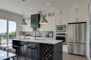 Photo 3: 158 69 Street SW in Calgary: Strathcona Park Detached for sale : MLS®# A1122439