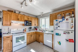Photo 4: 38 Coverdale Way NE in Calgary: Coventry Hills Detached for sale : MLS®# A1120881