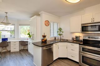 """Photo 6: 405 13900 HYLAND Road in Surrey: East Newton Townhouse for sale in """"HYLAND GROVE"""" : MLS®# R2605860"""