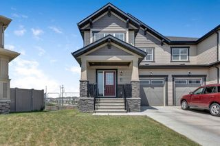Main Photo: 129 Hillcrest Square SW: Airdrie Semi Detached for sale : MLS®# A1128897