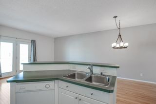 Photo 8: 31 Hamptons Link NW in Calgary: Hamptons Row/Townhouse for sale : MLS®# A1067738