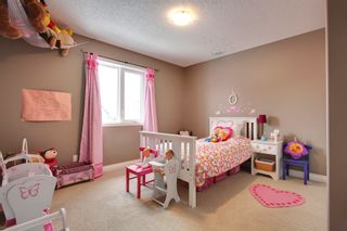 Photo 14: 131 Cougar Plateau Circle SW in Calgary: 2 Storey for sale : MLS®# C3614218