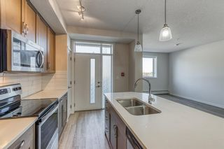 Photo 5: 12 30 Shawnee Common SW in Calgary: Shawnee Slopes Apartment for sale : MLS®# A1106401