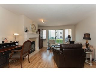 "Photo 3: 109 33110 GEORGE FERGUSON Way in Abbotsford: Central Abbotsford Condo for sale in ""Tiffany Park"" : MLS®# R2189830"