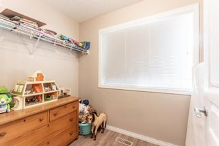 Photo 18: 103 Everridge Gardens SW in Calgary: Evergreen Row/Townhouse for sale : MLS®# A1061680