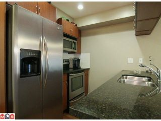 """Photo 2: 405 5516 198 Street in Langley: Langley City Condo for sale in """"Madison Villa"""" : MLS®# R2229071"""
