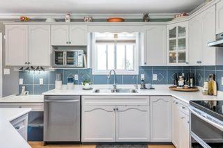 "Photo 13: 41706 KEITH WILSON Road in Chilliwack: Greendale Chilliwack House for sale in ""Greendale Chilliwack"" (Sardis)  : MLS®# R2602306"