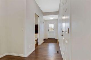 Photo 3: 333 Heartland Crescent: Cochrane Semi Detached for sale : MLS®# A1063240