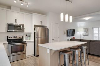 Photo 3: 416 LEGACY Point SE in Calgary: Legacy Row/Townhouse for sale : MLS®# A1062211