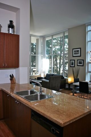 "Photo 6: 110 9266 UNIVERSITY Crescent in Burnaby: Simon Fraser Univer. Condo for sale in ""AURORA"" (Burnaby North)  : MLS®# V780352"