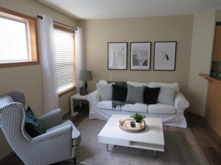 Photo 2: 17 Eversyde Court SW in Calgary: Evergreen Row/Townhouse for sale : MLS®# A1120200