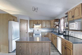 Photo 11: 39 Riverview Close: Cochrane Detached for sale : MLS®# A1079358