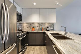 Photo 4: 405 519 Riverfront Avenue SE in Calgary: Downtown East Village Apartment for sale : MLS®# A1081632
