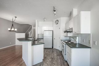 Photo 7: 31 Hamptons Link NW in Calgary: Hamptons Row/Townhouse for sale : MLS®# A1067738