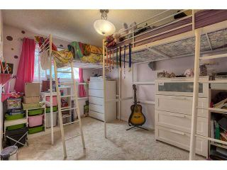 Photo 11: 869 QUEENSLAND Drive SE in CALGARY: Queensland Residential Attached for sale (Calgary)  : MLS®# C3616074