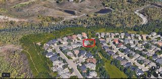 Photo 1: 1551 Evergreen Hill SW in Calgary: Evergreen Detached for sale : MLS®# A1050564