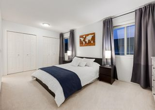 Photo 29: 218 950 ARBOUR LAKE Road NW in Calgary: Arbour Lake Row/Townhouse for sale : MLS®# A1136377