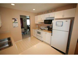 Photo 3: 146 388 SANDARAC Drive NW in CALGARY: Sandstone Townhouse for sale (Calgary)  : MLS®# C3460112