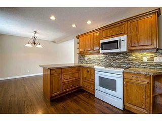 Photo 3: 1708 107 Avenue SW in Calgary: Braeside_Braesde Est Residential Detached Single Family for sale : MLS®# C3651455