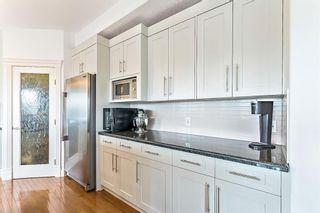 Photo 7: 52 Heritage Lake Mews: Heritage Pointe Detached for sale : MLS®# A1056186