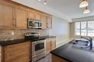 Photo 5: 2341 2330 FISH CREEK Boulevard SW in Calgary: Evergreen Apartment for sale : MLS®# A1064057