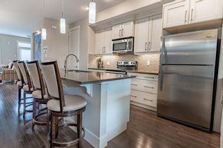 Photo 6: 270 Quarry Park Boulevard SE in Calgary: Douglasdale/Glen Row/Townhouse for sale : MLS®# A1141853