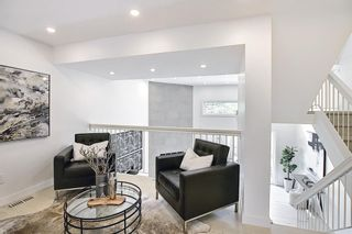 Photo 8: 64 Glamis Gardens SW in Calgary: Glamorgan Row/Townhouse for sale : MLS®# A1112302