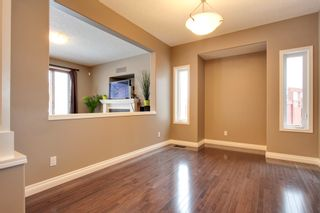 Photo 5: 131 Cougar Plateau Circle SW in Calgary: 2 Storey for sale : MLS®# C3614218