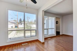 Photo 6: 7 6147 Buckthorn Road NW in Calgary: Thorncliffe Row/Townhouse for sale : MLS®# A1141165