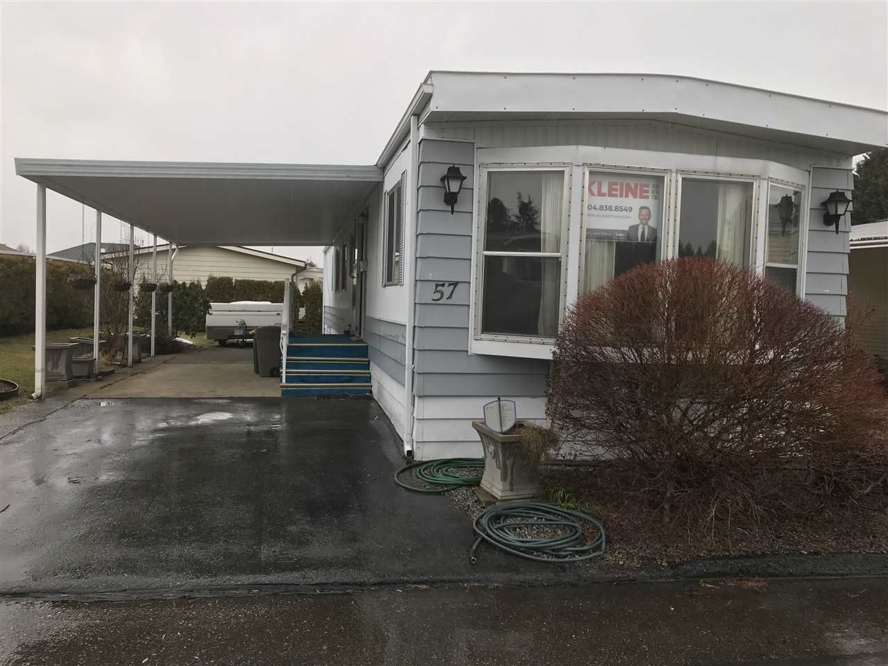 """Main Photo: 57 8254 134 Street in Surrey: Queen Mary Park Surrey Manufactured Home for sale in """"WESTWOOD ESTATES"""" : MLS®# R2344334"""