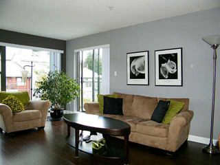 "Photo 1: 415 225 NEWPORT Drive in Port Moody: North Shore Pt Moody Condo for sale in ""Caledonia"" : MLS®# V1141316"