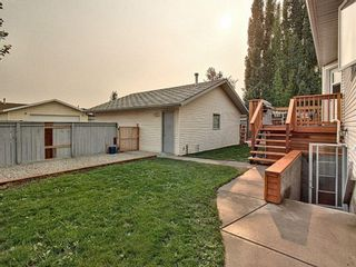 Photo 28: 36 West Boothby Crescent: Cochrane Detached for sale : MLS®# A1135637