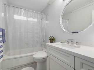 """Photo 16: 38 889 TOBRUCK Avenue in North Vancouver: Hamilton Townhouse for sale in """"TOBRUCK GARDENS"""" : MLS®# R2209623"""