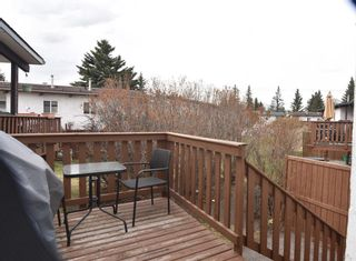 Photo 2: 217 Pinemont Road NE in Calgary: Pineridge Row/Townhouse for sale : MLS®# A1103067