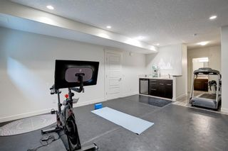 Photo 31: 127 Springbluff Boulevard SW in Calgary: Springbank Hill Detached for sale : MLS®# A1140601
