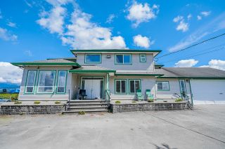 Photo 2: 19899 CONNECTING Road in Pitt Meadows: North Meadows PI House for sale : MLS®# R2595660