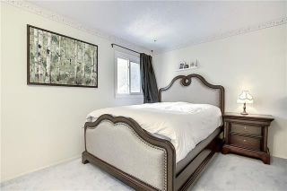 Photo 22: 24 GLAMIS Gardens SW in Calgary: Glamorgan Row/Townhouse for sale : MLS®# A1077235